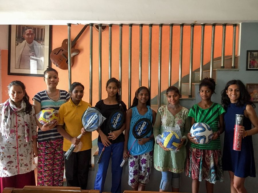 Anuva Shandilya, right, donates sports equipment this June to SOS Children's Villages in Faridabad, India.