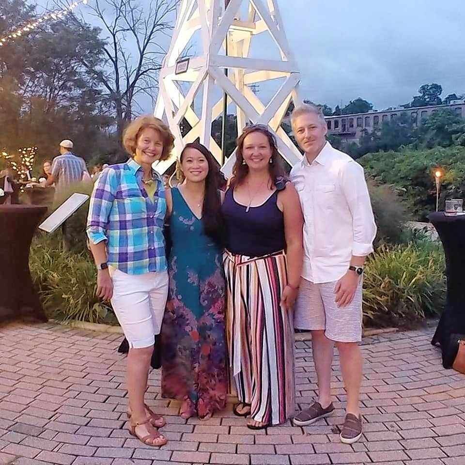 "Christopher Faber, right, was introduced as the new Batavia MainStreet executive director at the organization's July 21 ""Cocktails in the Park"" fundraiser. Here, he meets with former directors Britta McKenna, left, Joi Cuartero and Jamie Saam."