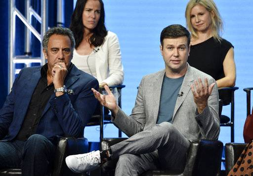"Taran Killam, front right, a cast member in the Disney ABC television series ""Single Parents,"" answers a question as fellow cast member Brad Garrett, front left, executive producer Katherine Pope, top left, and co-creator/executive producer JJ Philbin look on during the 2018 Television Critics Association Summer Press Tour Tuesday."