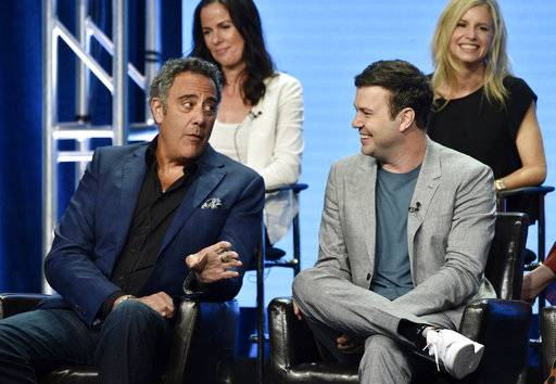 "Brad Garrett, left, a cast member in the Disney ABC television series ""Single Parents,"" gestures to fellow cast member Taran Killam, right, as executive producer Katherine Pope, top left, and co-creator/executive producer JJ Philbin look on during the 2018 Television Critics Association Summer Press Tour, Tuesday, Aug. 7, 2018, in Beverly Hills, Calif. (Photo by Chris Pizzello/Invision/AP)"
