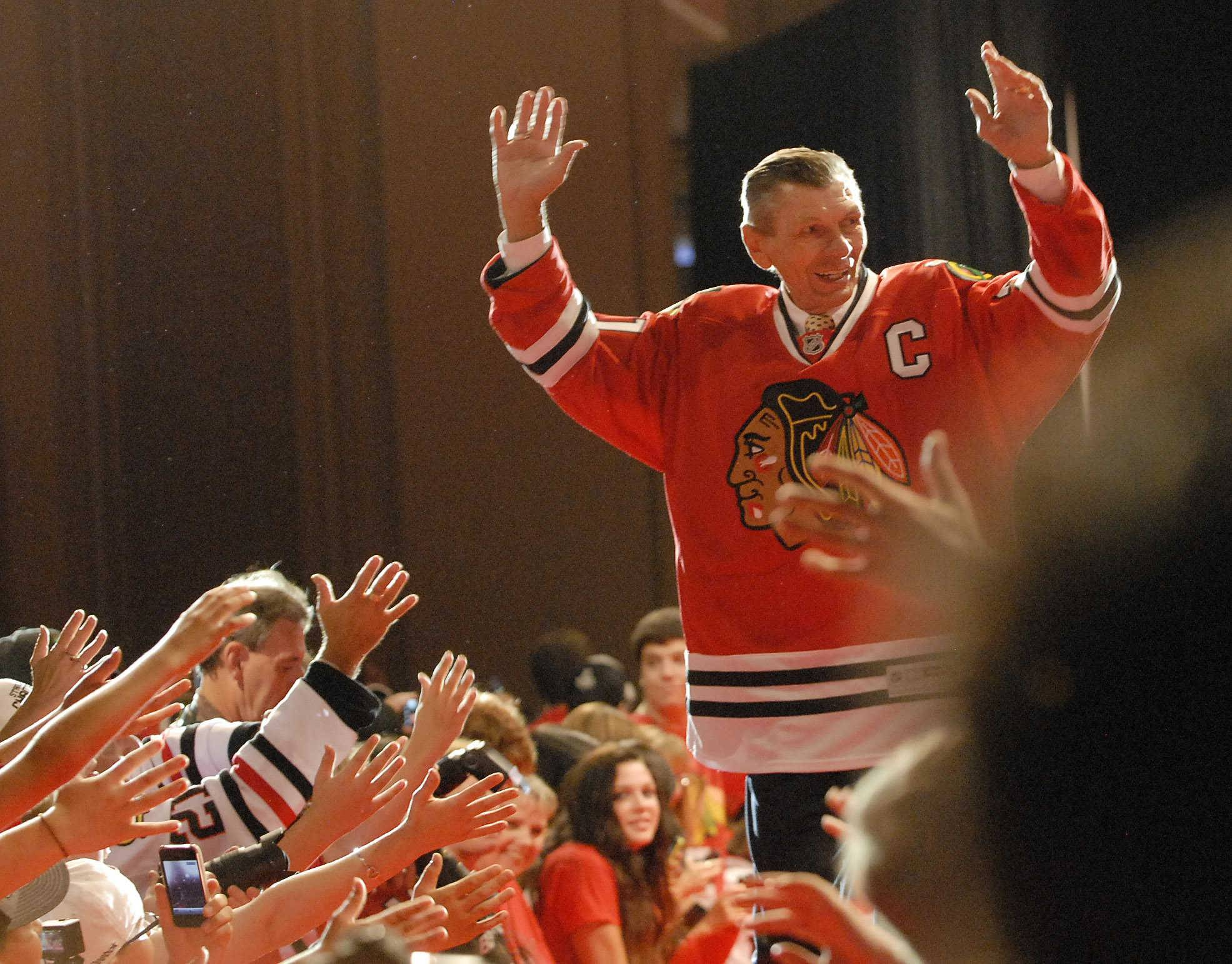 "Stan Mikita is introduced at a Blackhawks Convention. ""Stosh"" died this week at age 78 and take his place among the legends in Chicago sports history who have died and left behind a legacy we will always celebrate."