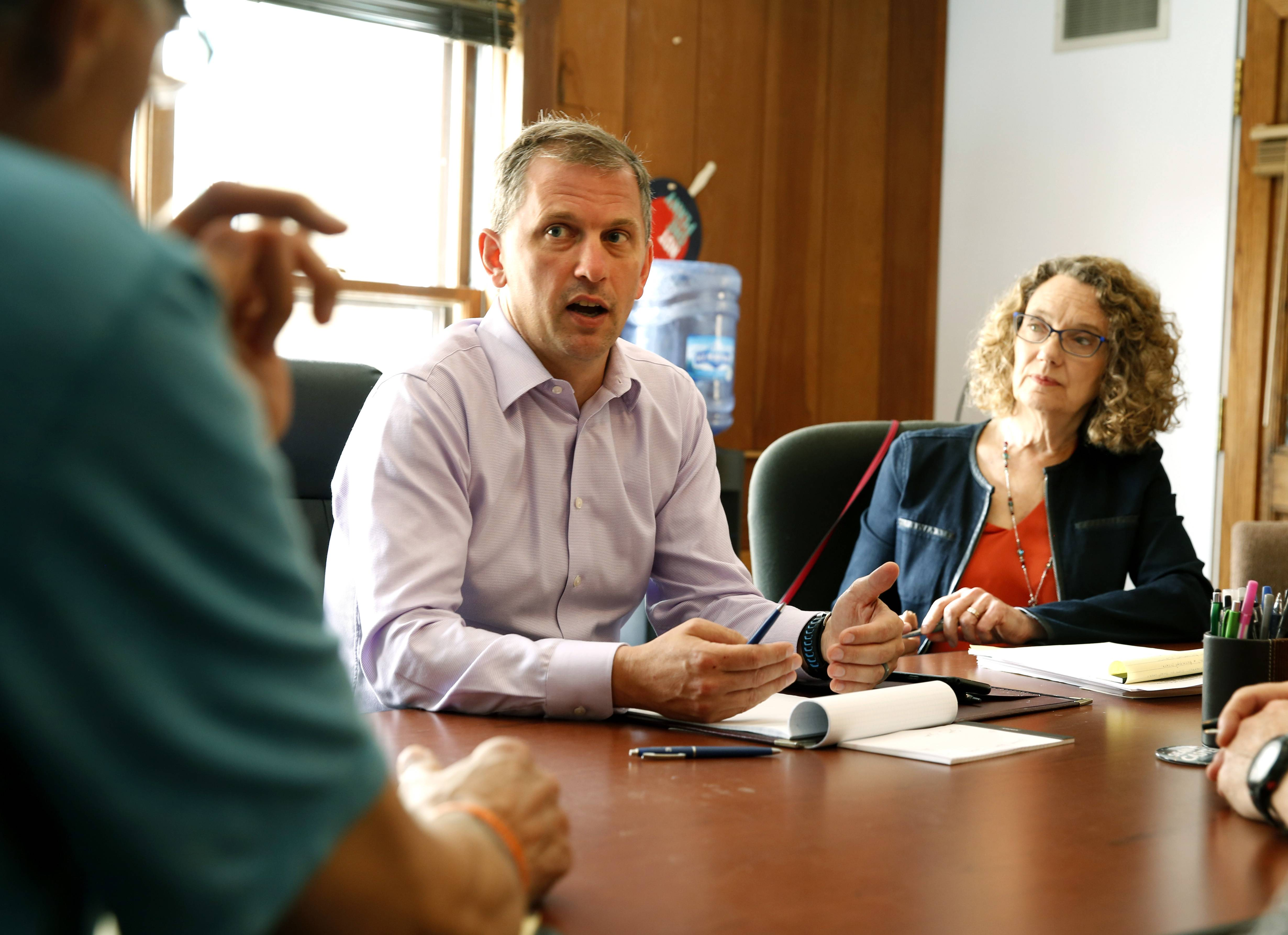 Meeting with constituents, such as Sandra Alexander of Glen Ellyn, right, is a part of the daily campaign trail for Downers Grove Democrat Sean Casten as he runs for U.S. Congress in the 6th District against incumbent Republican Rep. Peter Roskam of Wheaton.
