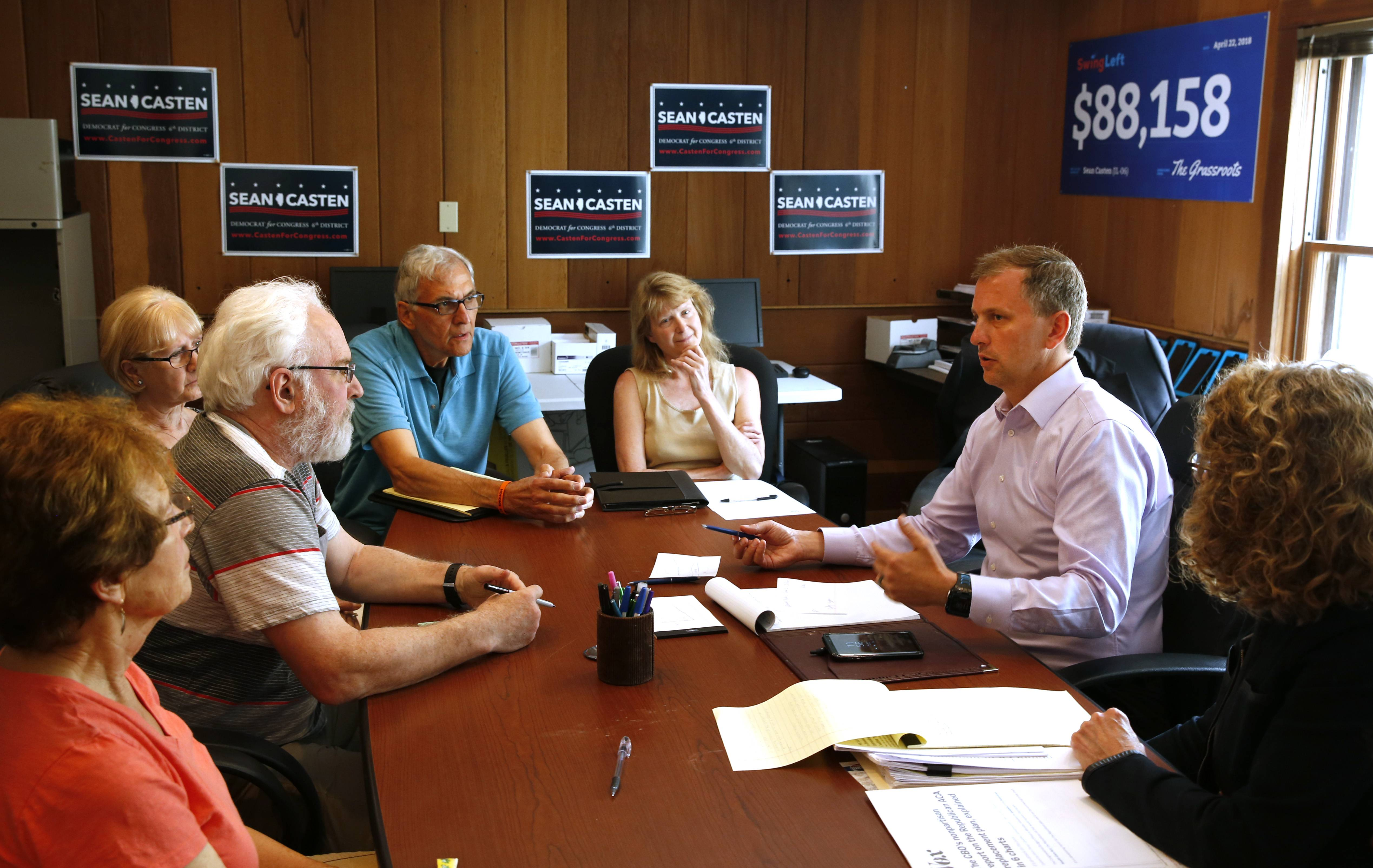 Sean Casten, right, the Democratic candidate for the 6th U.S. Congressional District seat, talks about health care with members of a constituent group called West Indivisible Suburban Engage.