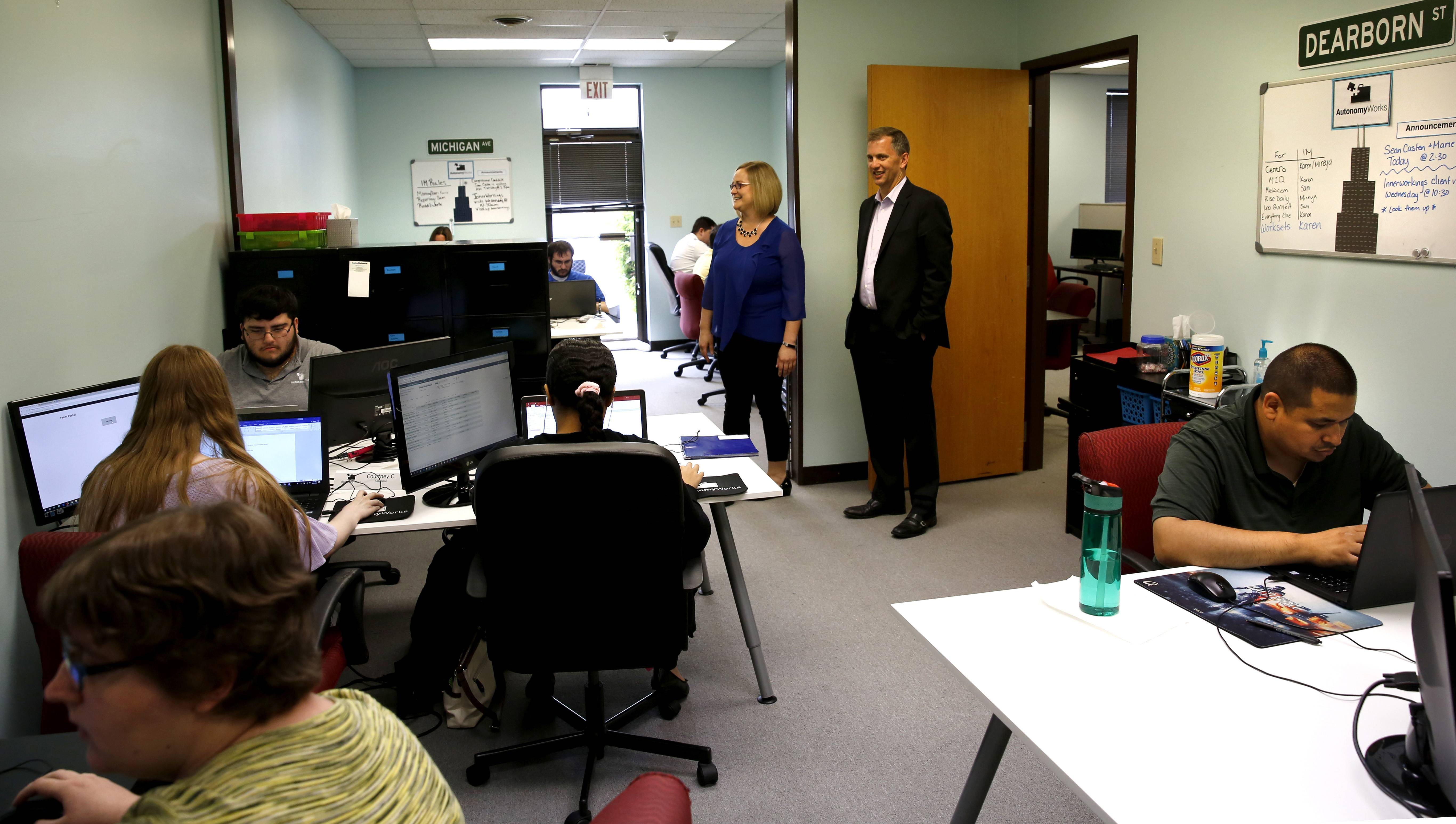 Sean Casten tours the office of AutonomyWorks in Downers Grove, which employs people with mid-functioning autism to do the technical work of digital marketing, advertising and analytics.