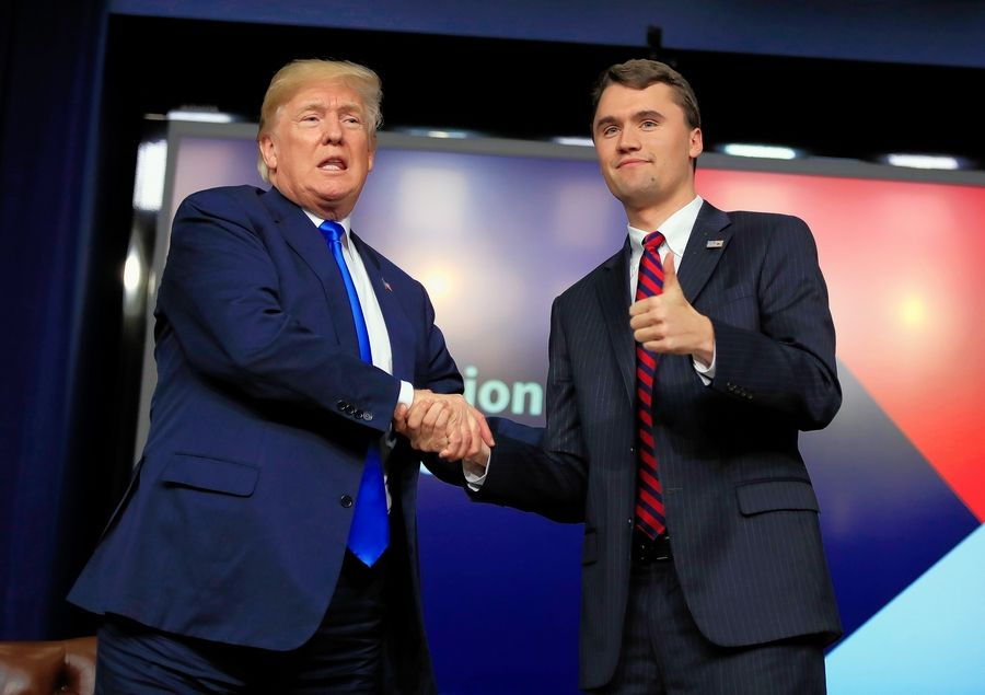 President Donald Trump shakes hands with moderator Charlie Kirk, a Wheeling High School alumnus, on March 22, 2018, during a Generation Next White House forum in Washington, D.C.