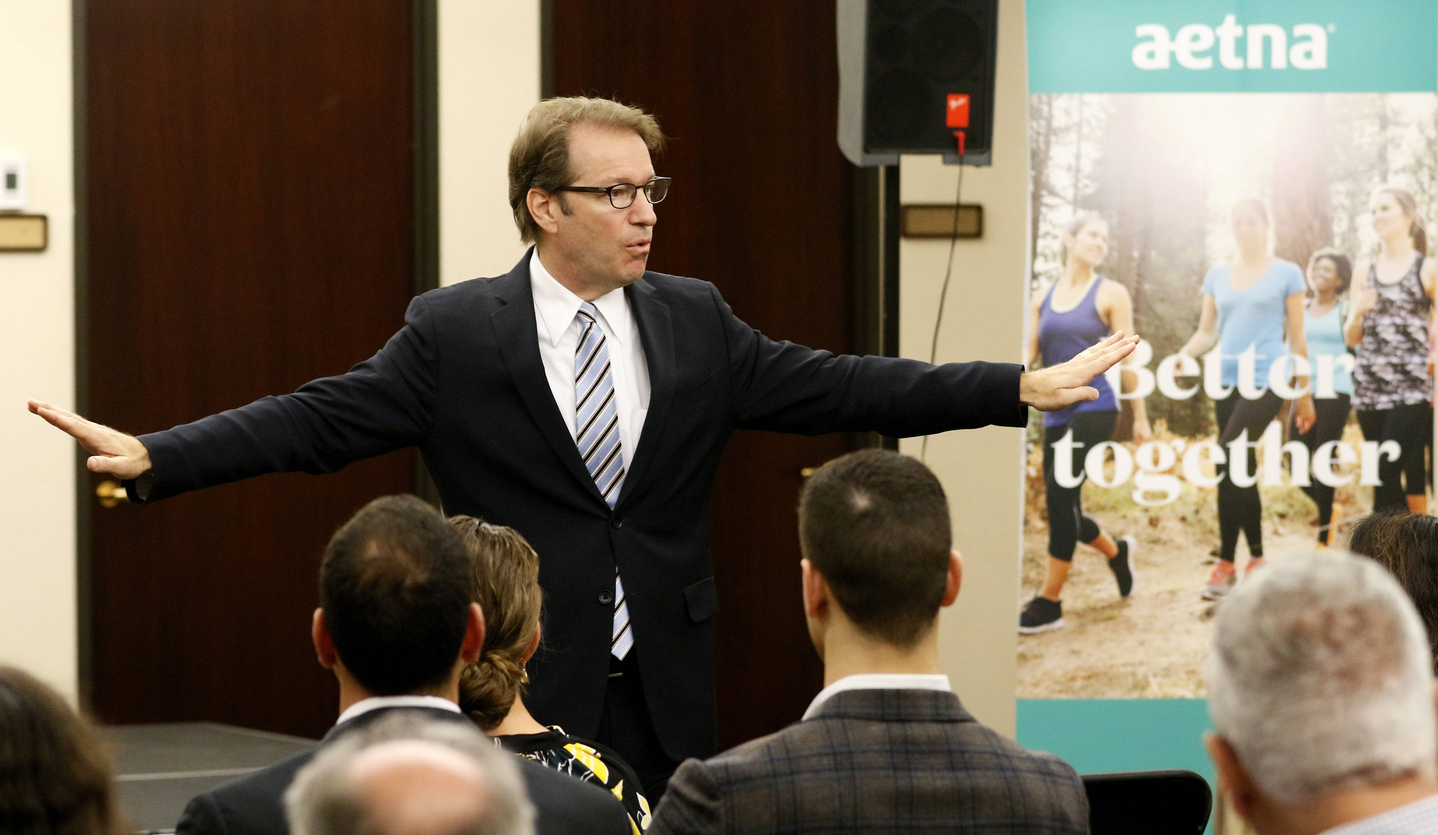 Peter Roskam tells Aetna employees he is asking questions of health industry leaders to try to remove unnecessary regulatory burdens and make progress on the nation's health care debate.