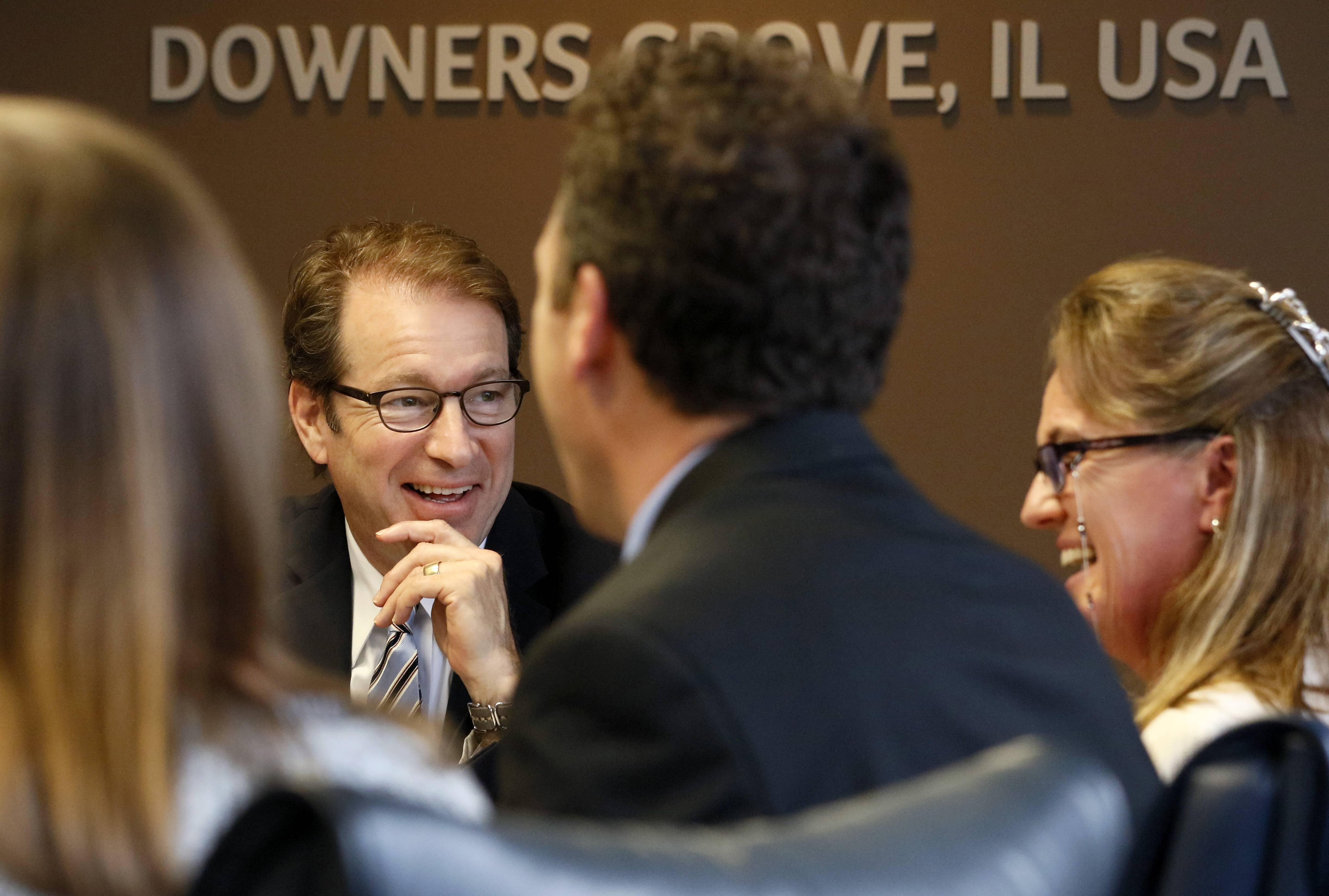 U.S. Rep. Peter Roskam of Wheaton listens to Sue Martin, right, clinical manager of the Aetna health Guardian Angel program, as she shares her work against the opioid crisis. Roskam visited Aetna while on the campaign trail. See more at dailyherald.com/video.