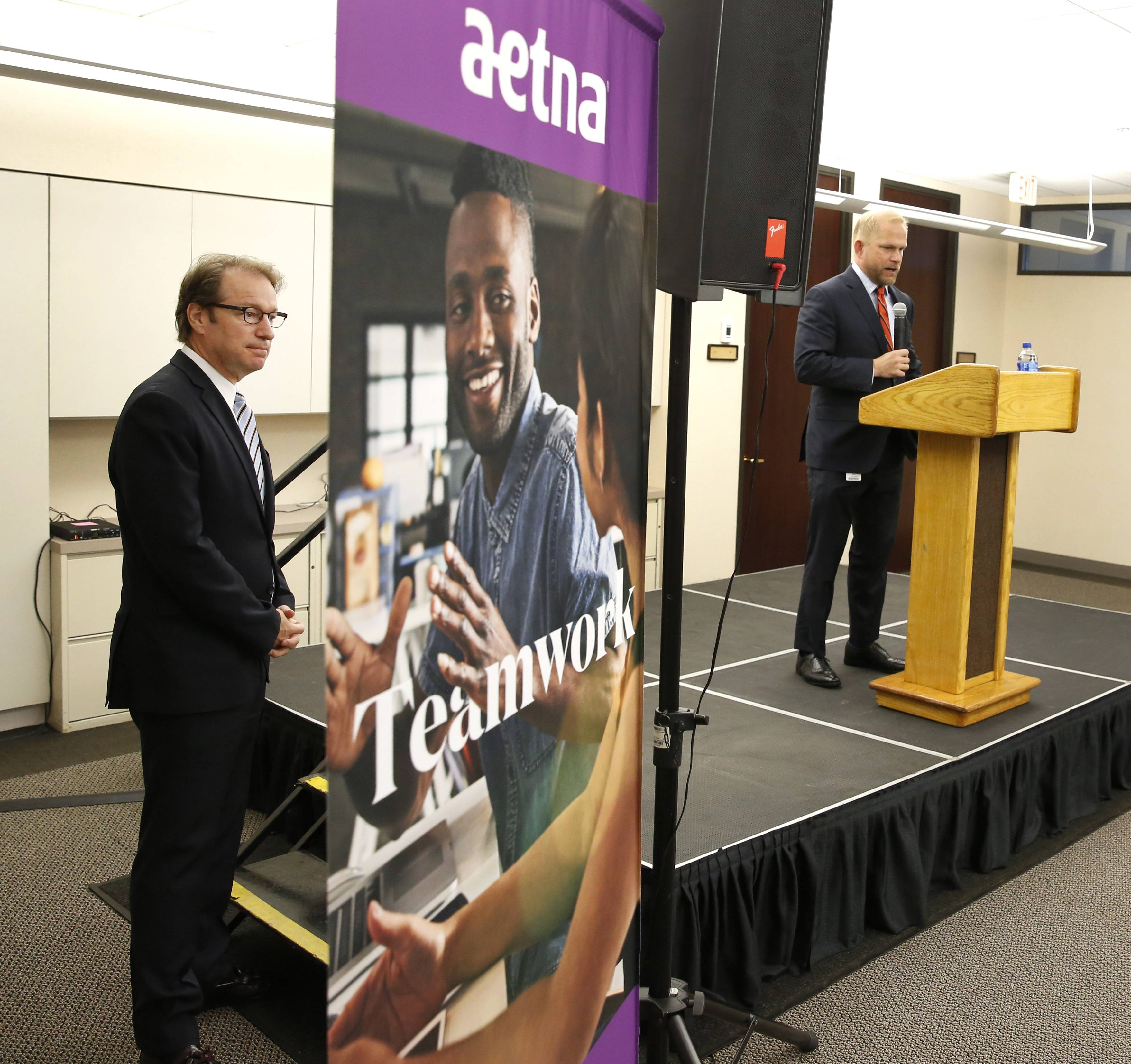 U.S. Rep. Peter Roskam waits for his introduction to speak to employees of the health insurance company Aetna in Downers Grove.