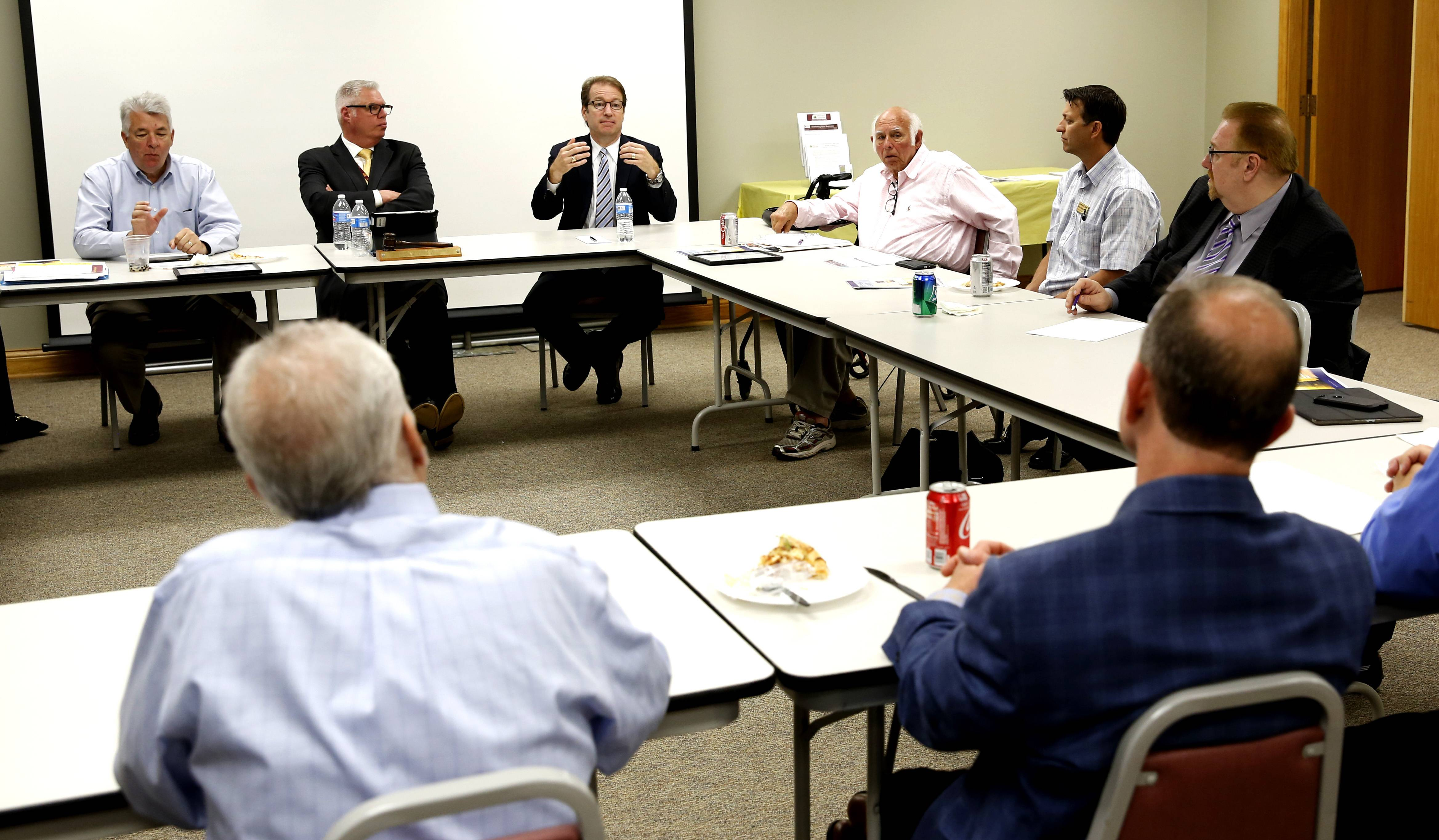 Congressman Peter Roskam listens to members of the Westmont Chamber of Commerce talk about their priorities.