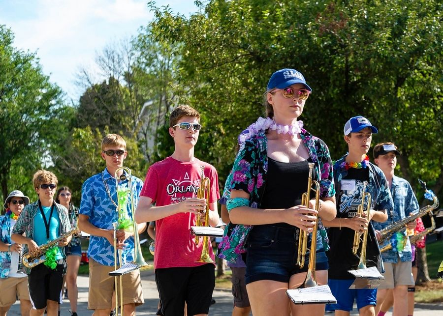 Members of the Palatine High School Marching Band march through the neighborhoods around the school during the annual band barbecue and parade.