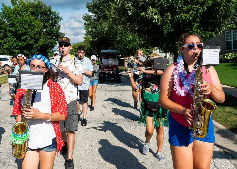 Members of the Palatine High School Marching Band parade through the residential neighborhoods around the school during their annual band barbecue and parade Aug. 2.