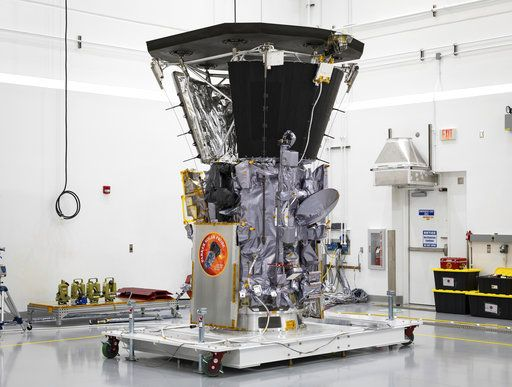 "This July 6, 2018 photo made available by NASA shows the Parker Solar Probe in a clean room at Astrotech Space Operations in Titusville, Fla., after the installation of its heat shield. NASA's Parker Solar Probe will be the first spacecraft to ""touch"" the sun, hurtling through the sizzling solar atmosphere and coming within just 3.8 million miles (6 million kilometers) of the surface. (Ed Whitman/Johns Hopkins APL/NASA via AP)"
