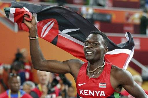FILE - In this Tuesday, Aug. 25, 2015, file photo, Kenya's Nicholas Bett celebrates after winning the men's 400m hurdles final at the World Athletics Championships at the Bird's Nest stadium in Beijing. The ex-hurdles world champion Bett, 28, has been killed in a road accident. Nandi county police commander Patrick Wambani says Bett was killed in the car crash early Wednesday morning near Kenya's high-altitude training region of Eldoret. Bett's coach Vincent Mumo says the athlete's SUV hit bumps in a road and rolled.