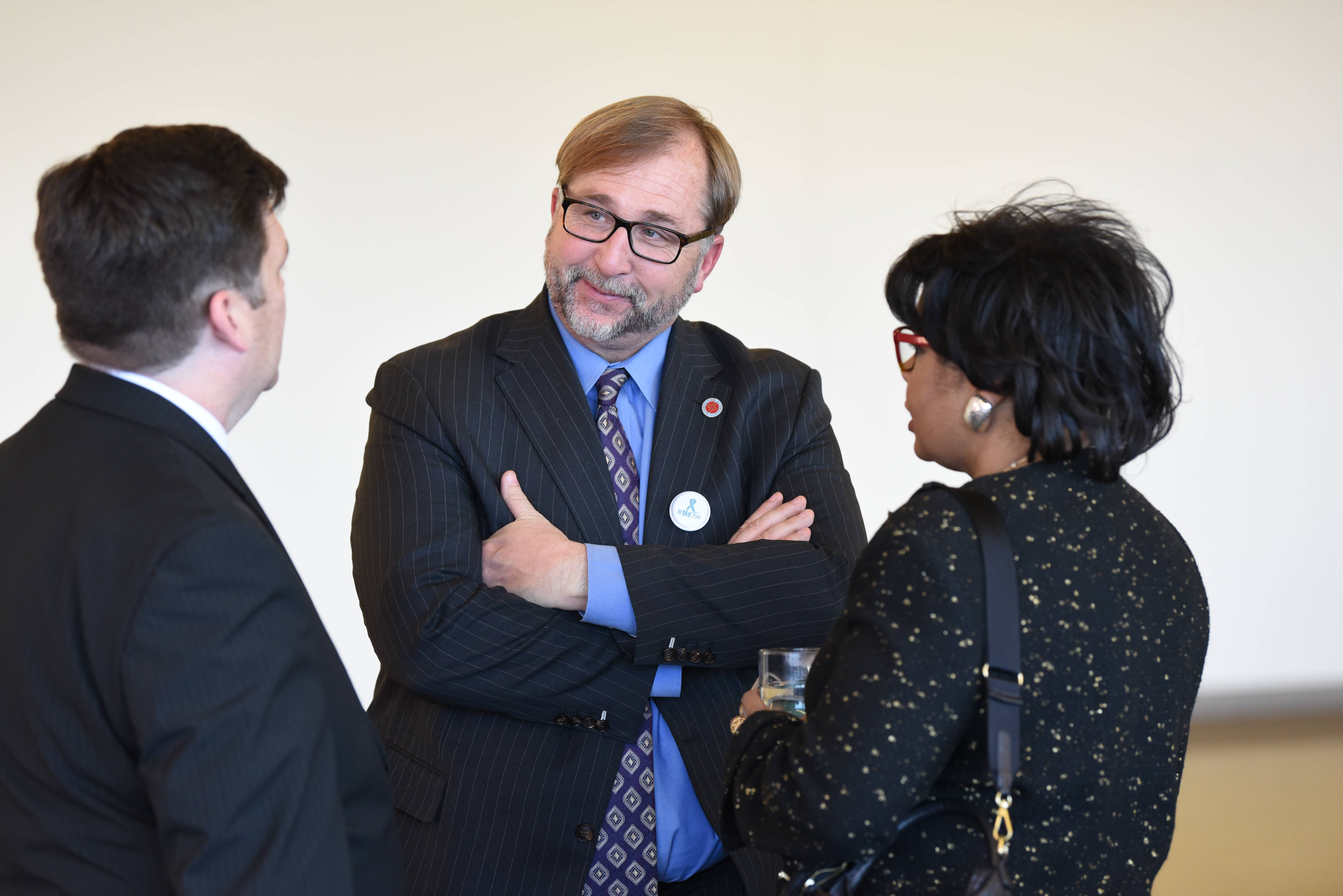 Jeff Knox/jknox@dailyherald.comDr. Michael Brophy, center, speaking to political CNN political contributor April Ryan, right, and Dr. Phillip Hardy during a speech by Ryan at Benedictine University in Lisle in 2017. Brophy is reportedly out as president of Benedictine University.