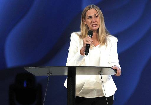 Willow Creek Community Church lead pastor Heather Larson speaks at the church, Wednesday, Aug. 8, 2018, in South Barrington, Ill. Larson said she is stepping down, and the entire Board of Elders will do so by the end of the year. Larson said the church needed new leadership in the wake of sexual harassment allegations against church founder Bill Hybels. (Steve Lundy/Daily Herald via AP)