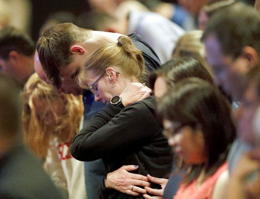 Audience members react as it was announced, Wednesday, Aug. 8, 2018, at Willow Creek Community Church in South Barrington, Ill., that lead pastor Heather Larson is stepping down, and the entire Board of Elders will do so by the end of the year. Larson said the church needed new leadership in the wake of sexual harassment allegations against church founder Bill Hybels. (Steve Lundy/Daily Herald via AP)