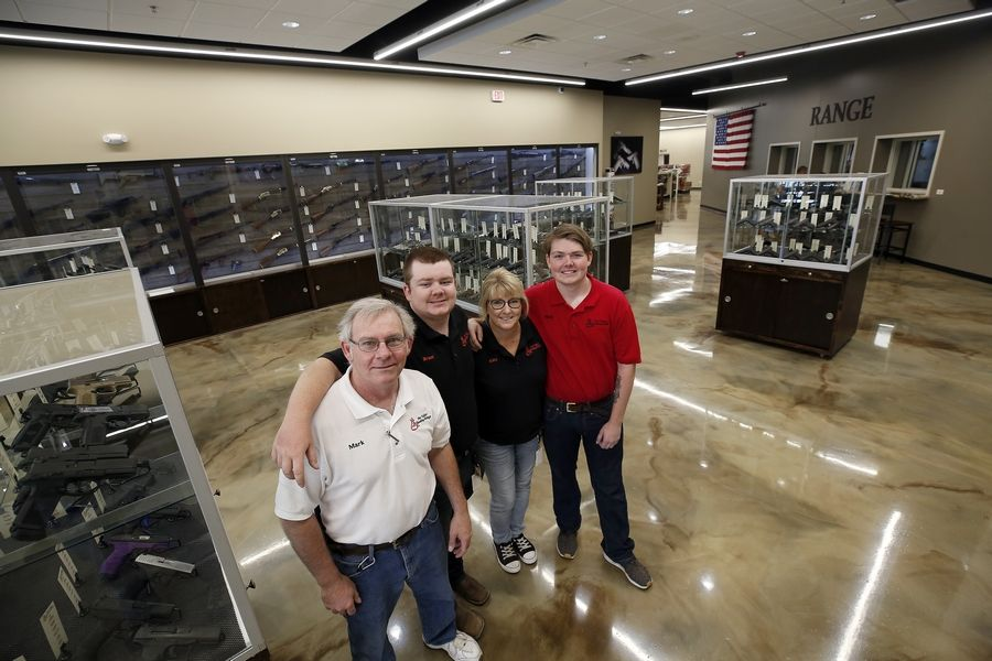 Fox Valley Shooting Range owner Mark Glavin, from left, and his son Brant, wife Kitty and son Mark at the business at 780 S. McLean Blvd. that opened last week in Elgin.