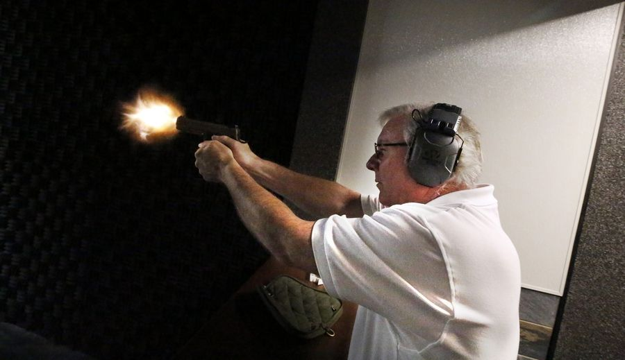 Owner Mark Glavin shoots in one of the two private bays at Fox Valley Shooting Range in Elgin. There are also 12 regular bays.