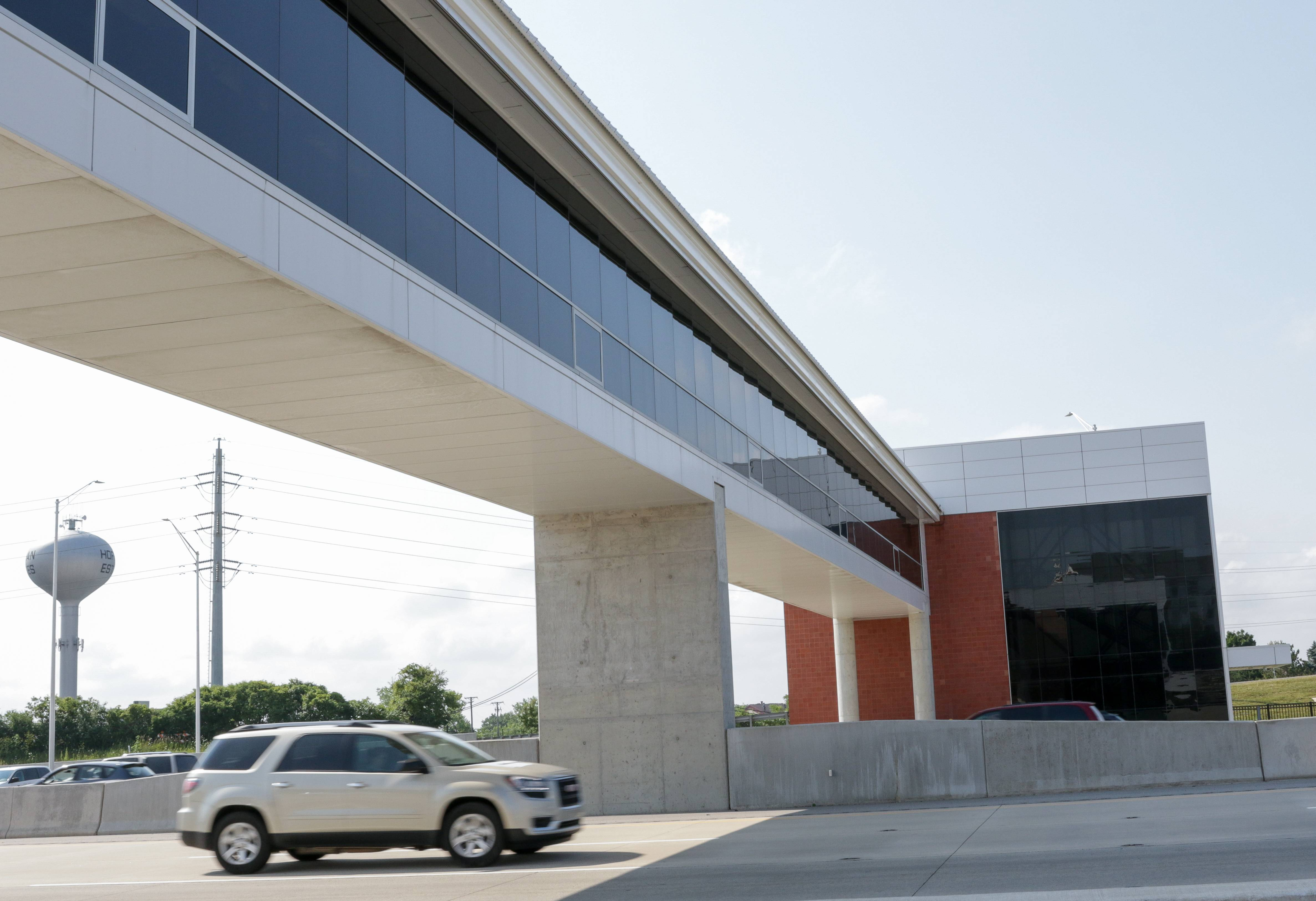 Pace and the Illinois tollway held a press preview Friday for a new transit station that will open Monday at I-90 and Barrington Road. A pedestrian bridge connects parking lots to the bus boarding lane.
