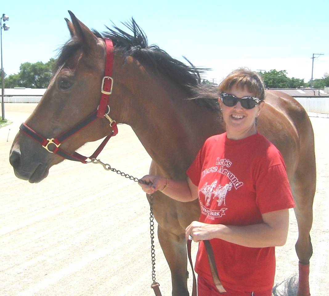 Author Kimberly A. Rinker with a Standardbred horse she owned and drove named Poco Hank.