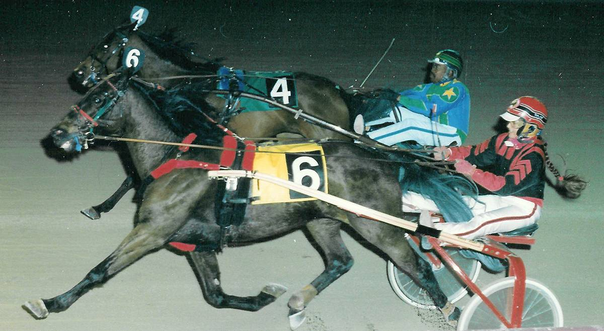 Author Kimberly A. Rinker driving in a harness race at Pompano Park in Florida and winning with a horse named Little Patch.