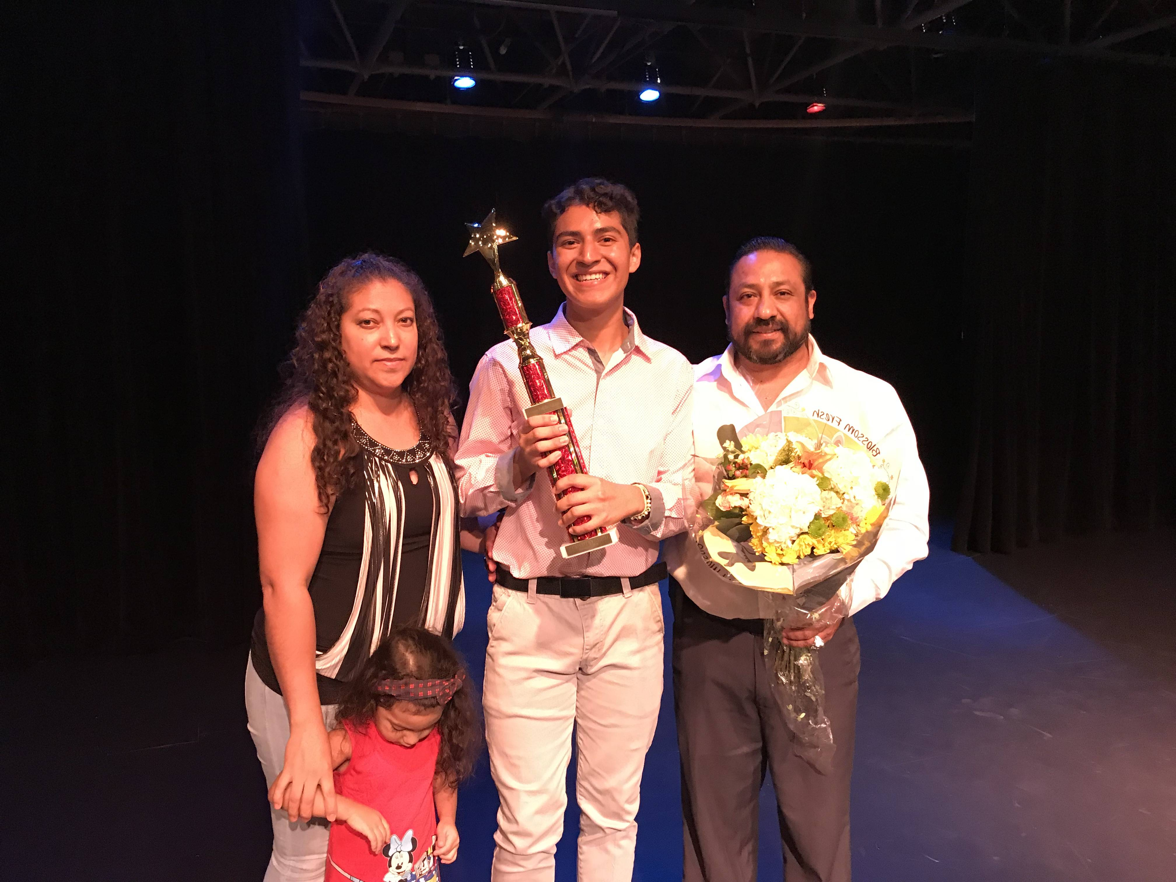 Jovany Hernandez, an East Aurora High junior, pictured with his family, is the winner of the 10th annual Teen Talent Show.