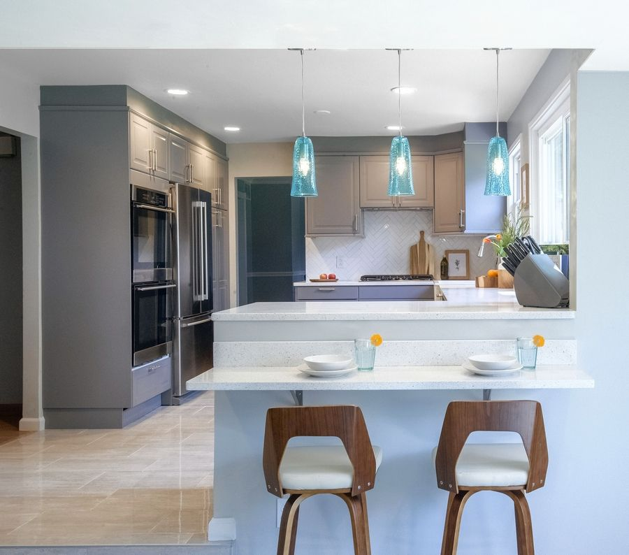 This fully renovated Cherry Hill, New Jersey, kitchen has three levels of lighting: recessed lighting, under-cabinet lighting and pendants over the new breakfast bar.