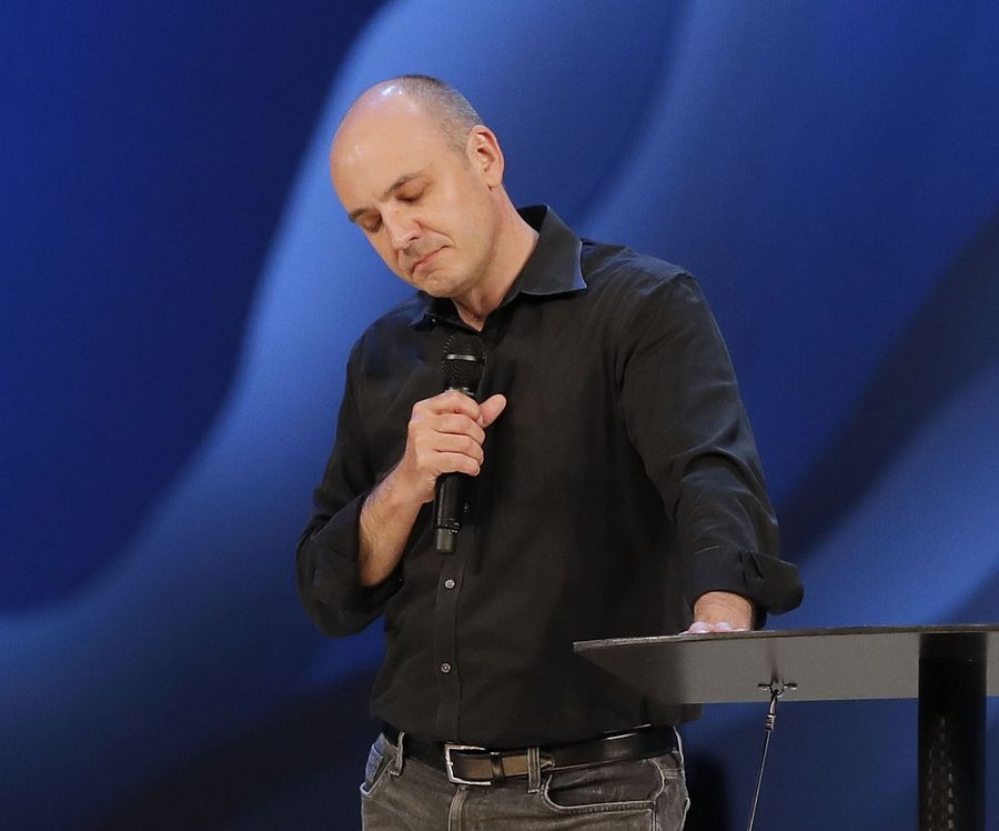 New interim Lead Pastor Steve Gillen prays with the congregation after leaders of Willow Creek Church resigned Wednesday night in South Barrington.