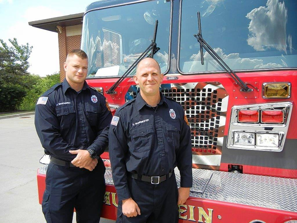 Mundelein firefighters Dan Mastandrea, left, and Dan Buhrmester finished an injured woman's yard chores after taking her to a hospital.