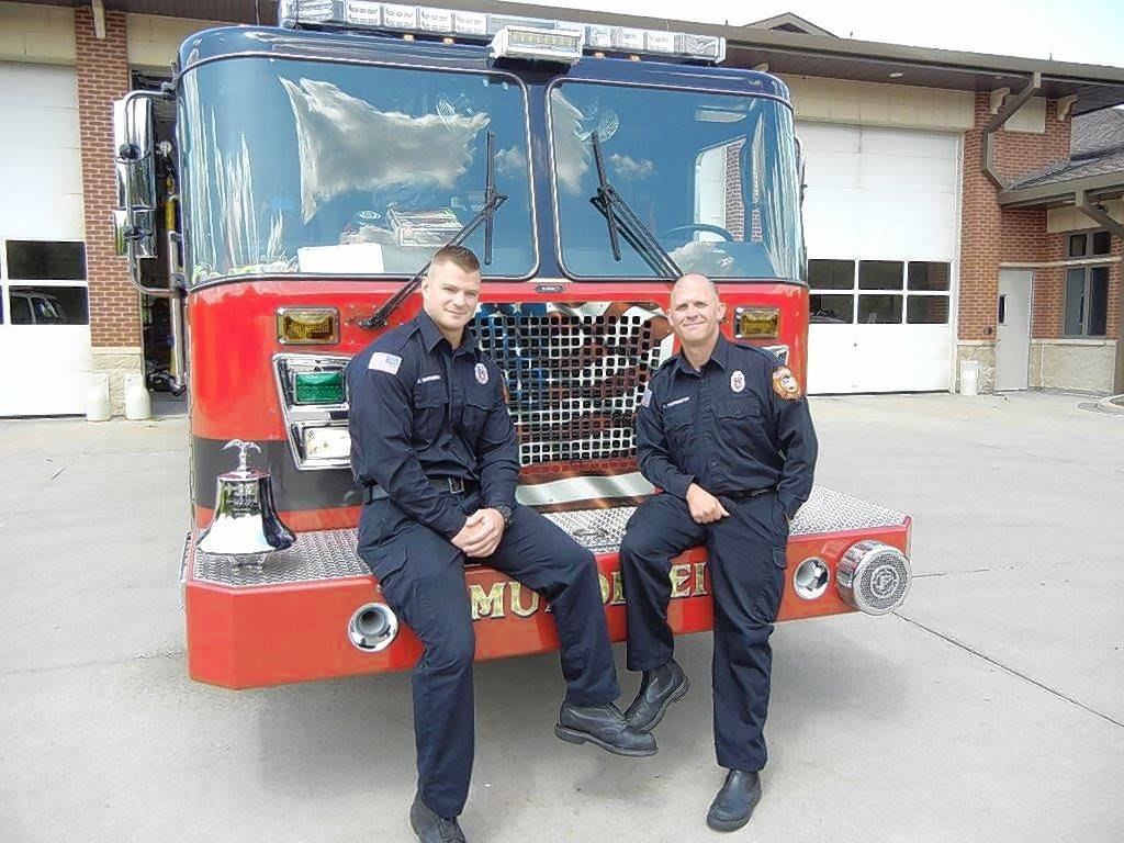 Mundelein firefighters Dan Mastandrea, left, and Dan Buhrmester saw that a woman they had just taken to the hospital took pride in her landscaping, so they finished the work for her.