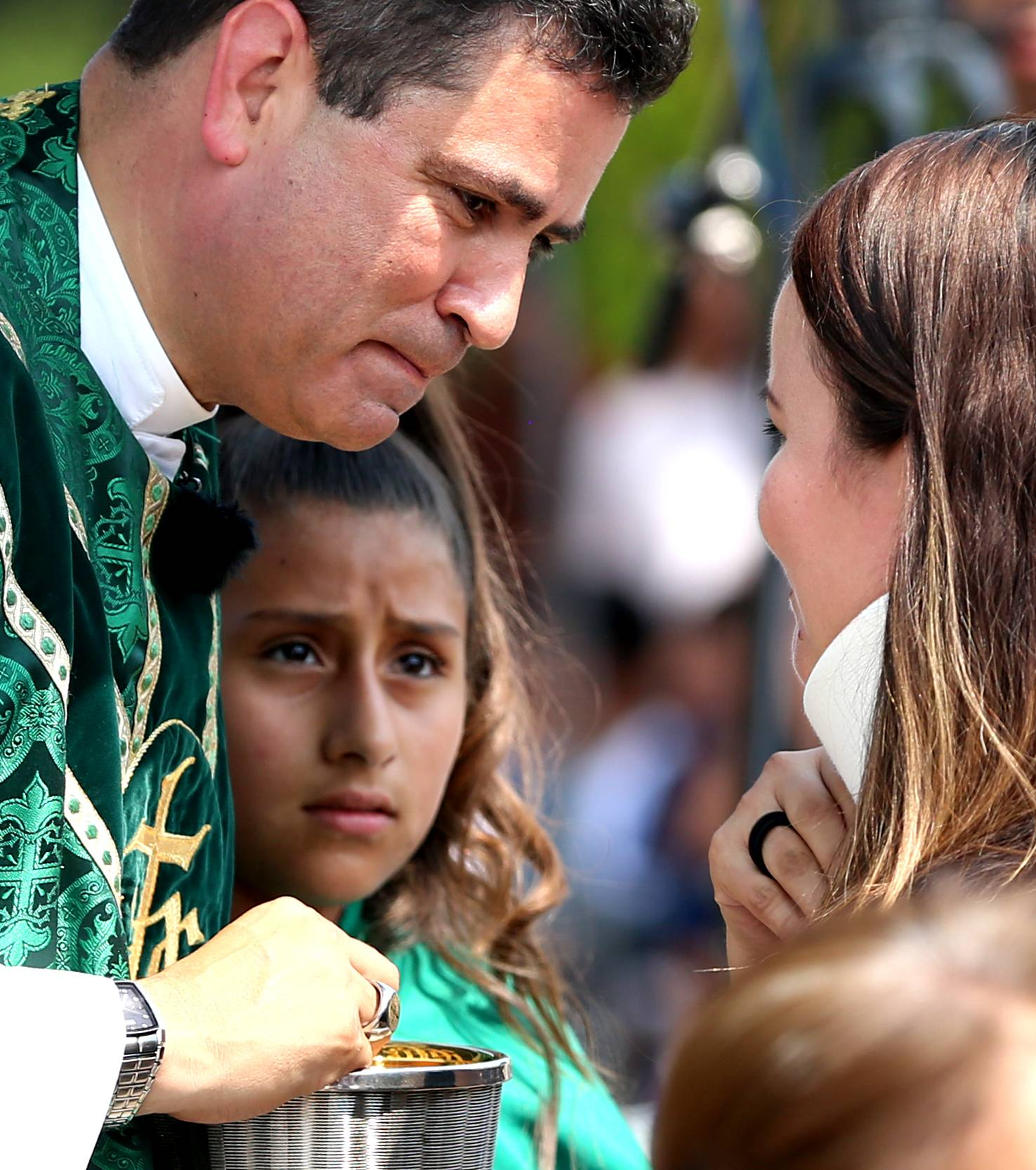 The Very Rev. Esequiel Sanchez shares a special word while offering Holy Communion to fellow plane crash survivor Sandra Alarcon of Northlake. Sanchez celebrated a mass of thanksgiving Sunday at the Shrine of Our Lady of Guadalupe.