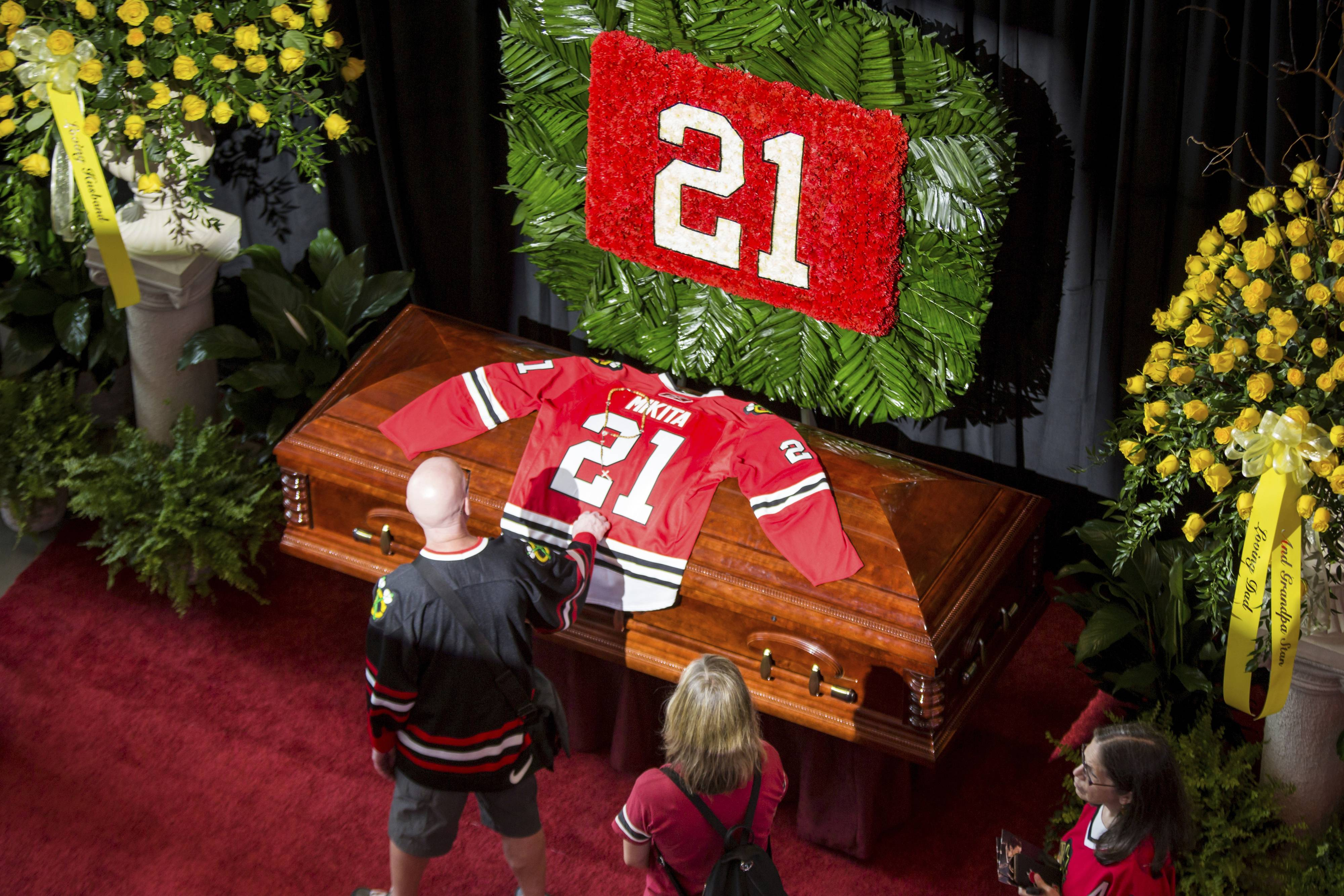 Fans pay their last respects at a memorial service for Chicago Blackhawk Stan Mikita at the United Center, Sunday, Aug. 12, 2018. Mikita, who helped lead the Blackhawks to the 1961 Stanley Cup title while becoming one of the franchise's most revered figures, died Tuesday. He was 78.