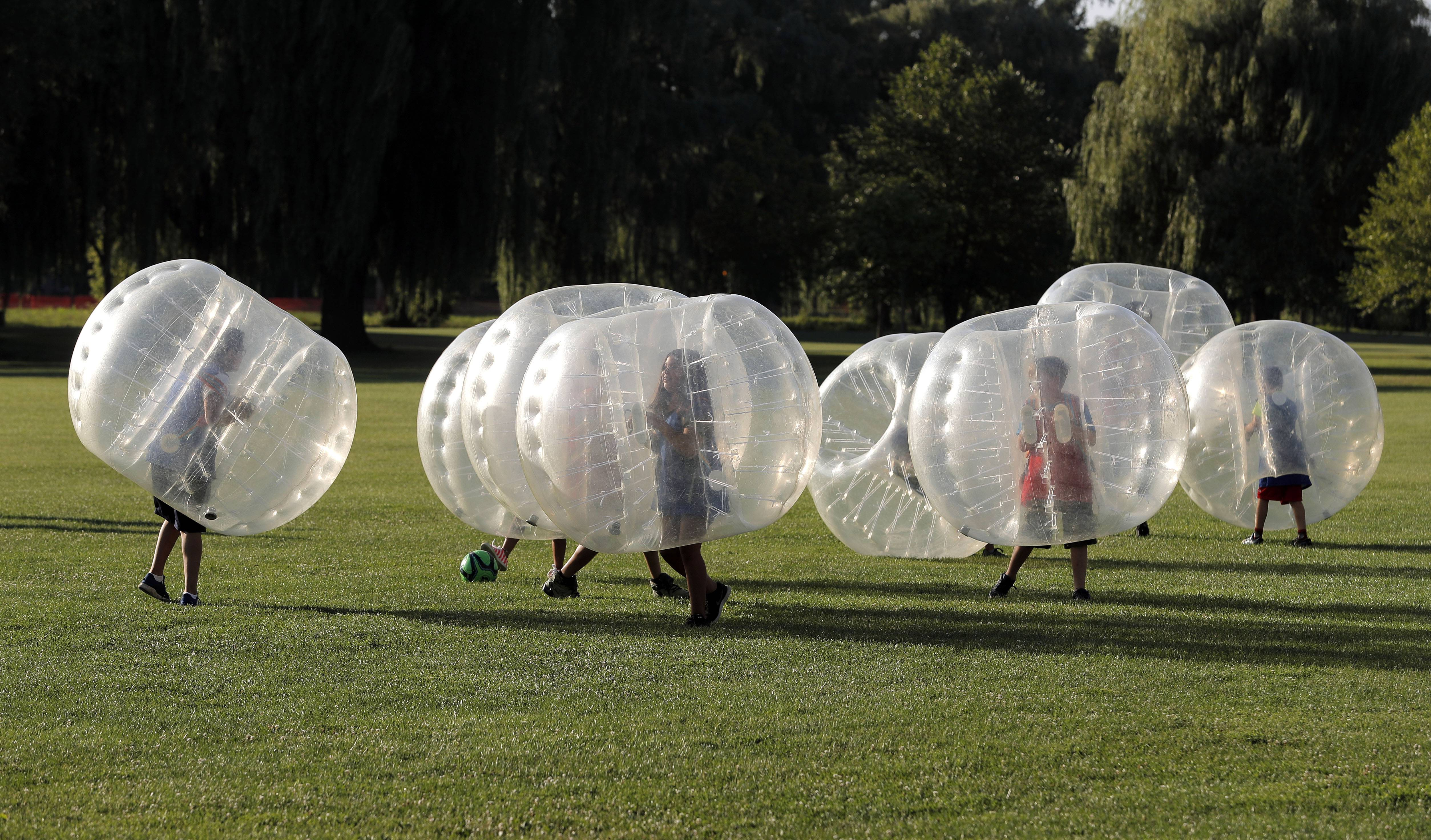 Kids play Bubble Soccer during Gurnee Days Friday in Viking Park.