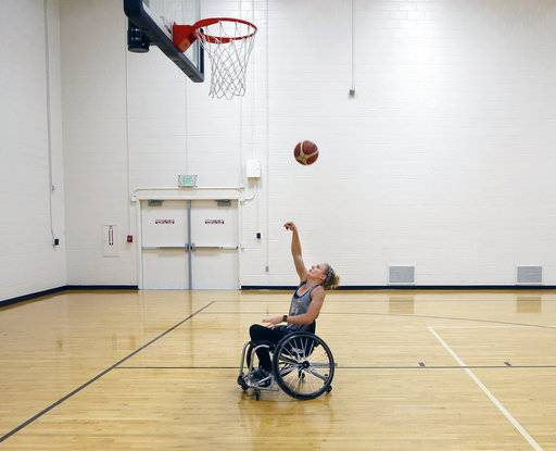 In this Tuesday, July 17, 2018 photo, Shelby Gruss works out at the France A. Cordova Recreational Sports Center on the campus of Purdue University in West Lafayette, Ind. Gruss is captain of the U.S. women's wheelchair basketball team. Gruss has been paralyzed from the waist down since suffering a spinal cord injury as a high school senior in 2010. She was captain of Team USA's women's wheelchair basketball team this month in the Dutch Battle in Amsterdam.  (John Terhune/Journal & Courier via AP)