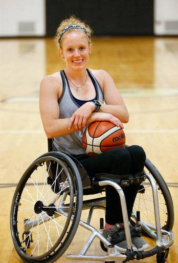 In this Tuesday, July 17, 2018 photo, Shelby Gruss pauses during her workout at the France A. Cordova Recreational Sports Center on the campus of Purdue University in West Lafayette, Ind. Gruss is captain of the U.S. women's wheelchair basketball team. Gruss has been paralyzed from the waist down since suffering a spinal cord injury as a high school senior in 2010. She was captain of Team USA's women's wheelchair basketball team this month in the Dutch Battle in Amsterdam.  (John Terhune/Journal & Courier via AP)