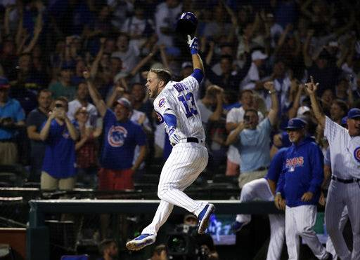 Chicago Cubs' David Bote reacts as he rounds the bases after hitting the game-winning grand slam against the Washington Nationals during the ninth inning of a baseball game Sunday, Aug. 12, 2018, in Chicago. The Cubs won 4-3.