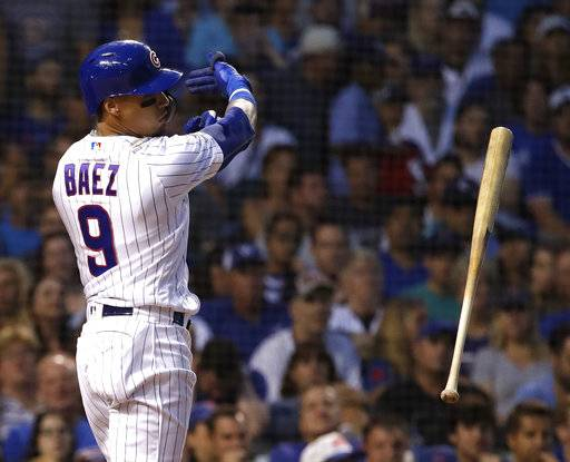 Chicago Cubs' Javier Baez throws his bat after striking out swinging during the third inning of a baseball game against the Washington Nationals, Sunday, Aug. 12, 2018, in Chicago.