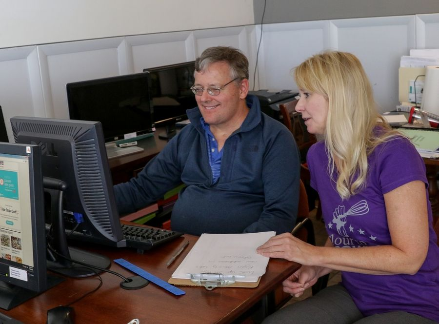 Deborah Giesler, director of Synapse House in Elmhurst, helps member Christopher Zinski with research. The nonprofit provides support to those with brain injuries.