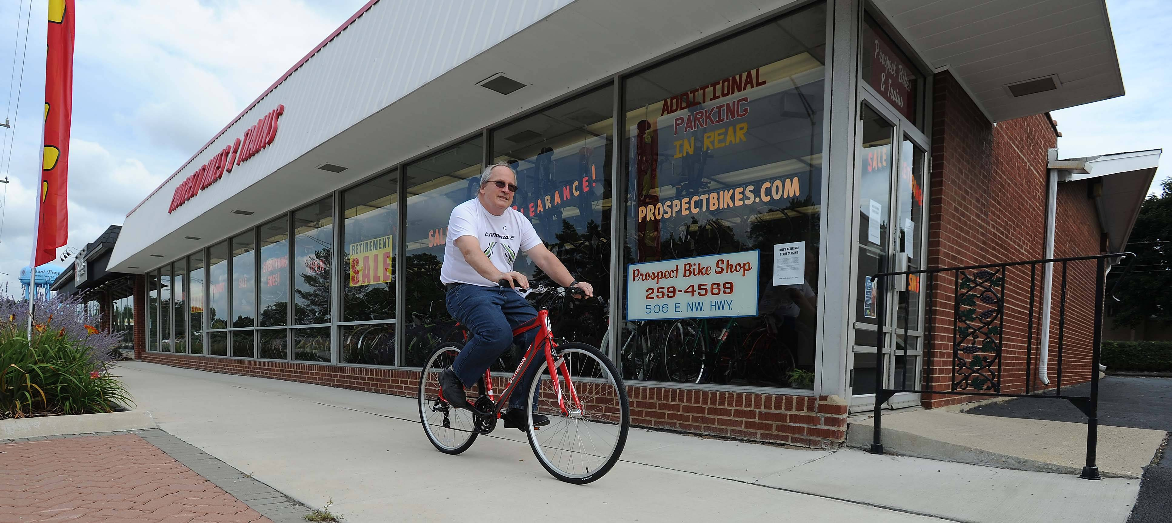 Bill Schmoldt, owner of Prospect Bikes in Mount Prospect tests out a new Schwinn bike outside his store. He is closing the store he has operated since 1979.