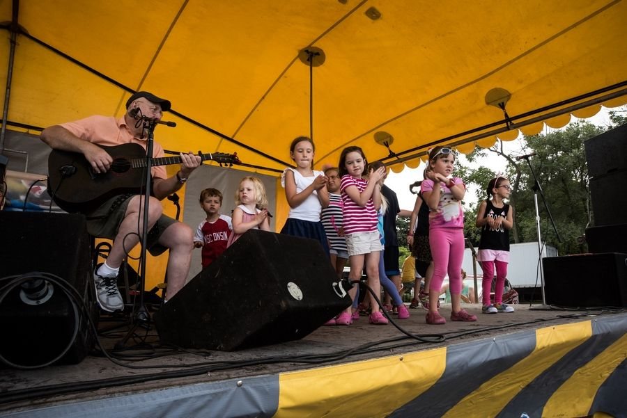 Young festivalgoers take the band shell stage with guitarist Dave Rudolf at a previous Summer Days in Grayslake. Rudolf will be back this year at 12:30 p.m. Saturday, Aug. 18.