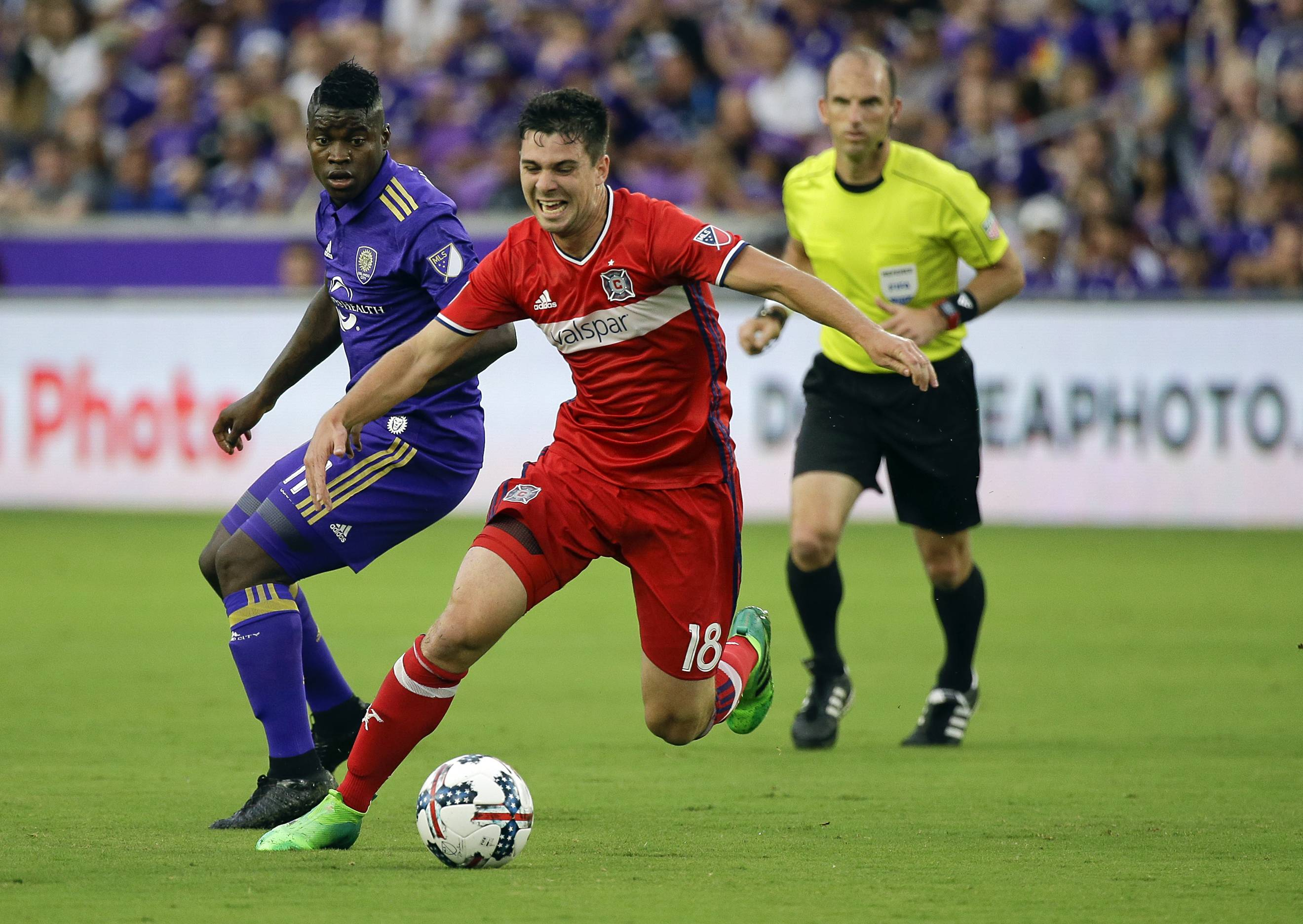 The Chicago Fire's Drew Conner moves the ball past Carlos Rivas, left, during the first half of an MLS soccer game, Sunday, June 4, 2017, in Orlando, Fla.