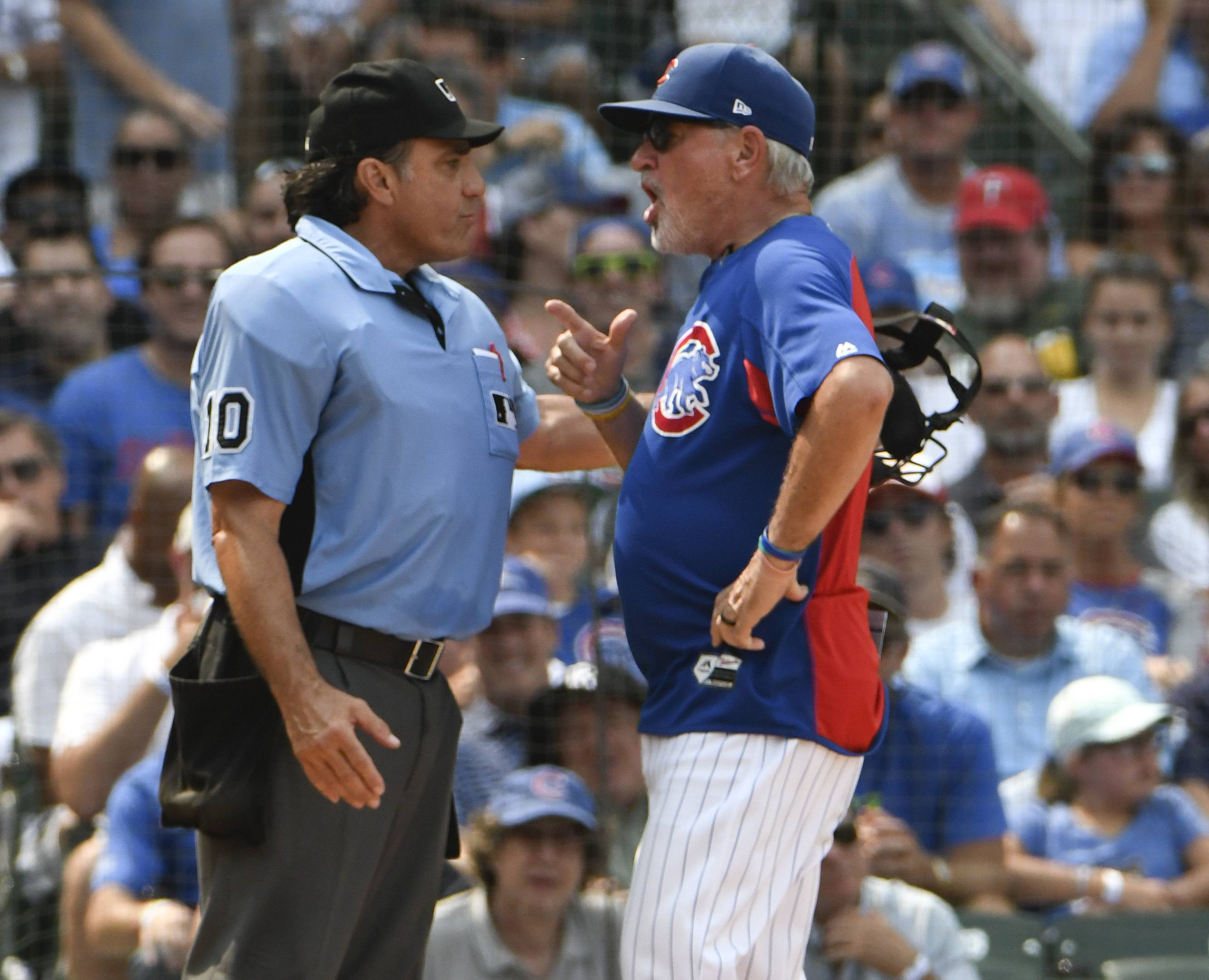Chicago Cubs manager Joe Maddon, right, argues a call with umpire Phil Cuzzi during the sixth inning Tuesday in Chicago.