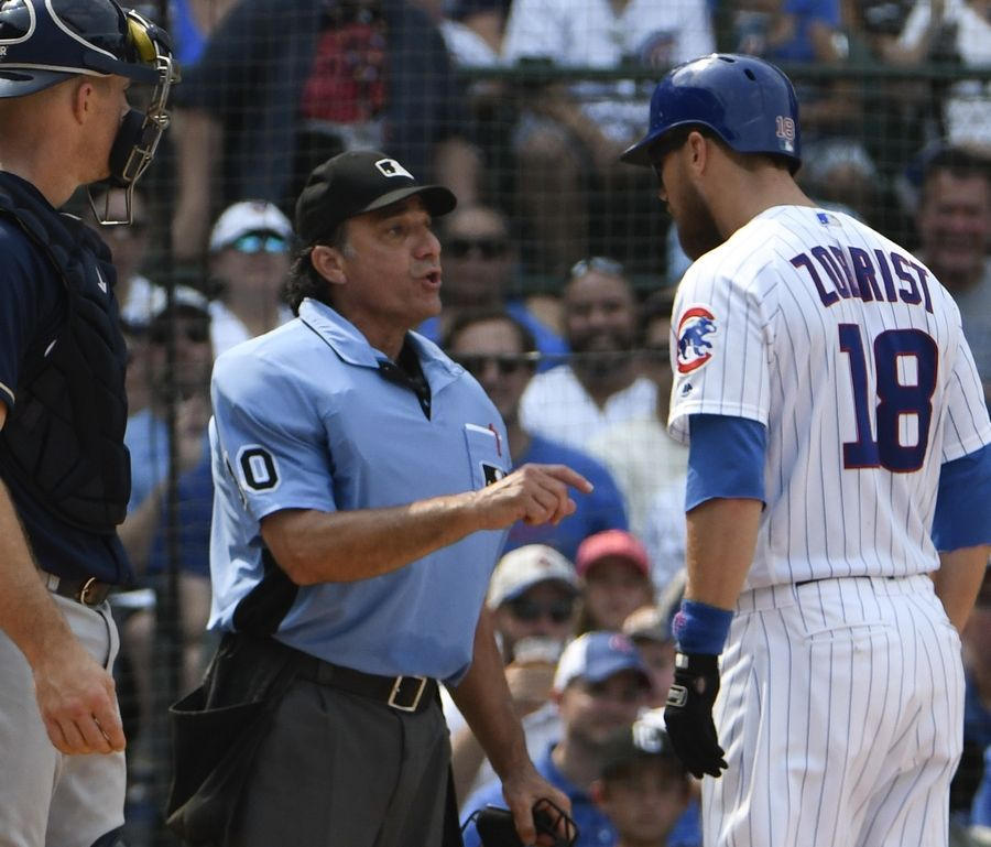 Chicago Cubs' Ben Zobrist argues a strike call with umpire Phil Cuzzi (10) during the sixth inning.