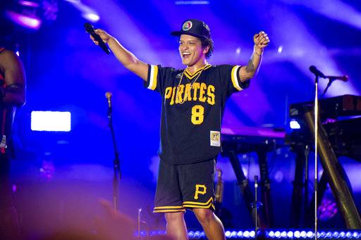 "FILE - In this May 27, 2018 file photo, Bruno Mars performs at the Bottle Rock Napa Valley Music Festival at Napa Valley Expo in Napa, Calif. Cardi B may have backed out of the Bruno Mars tour, but he's found four other acts to hit the road with him. Mars announced Tuesday, Aug. 14, 2018, that Boyz II Men, Charlie Wilson, Ciara and ""Boo'd Up"" singer Ella Mai will perform during his upcoming fall concerts on his 24K Magic World Tour. (Photo by Amy Harris/Invision/AP, File)"