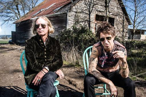 "This undated mage released by New West Records shows Peter Buck, left, and Joseph Arthur who released a collaboration album ""Arthur Buck."" (Dean Karr/New West Records via AP)"