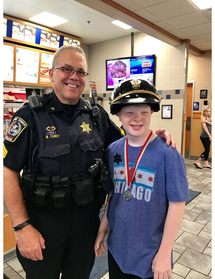 Lake Zurich Sgt. Martin Yundt poses with a local Special Olympian during last year's ButterBurgers & Badges fundraiser at Culver's restaurant on Rand Rd. Culver's and Special Olympics of Illinois will team again this August 30 for the 4th annual event. Dave Silbar/SilbarPR