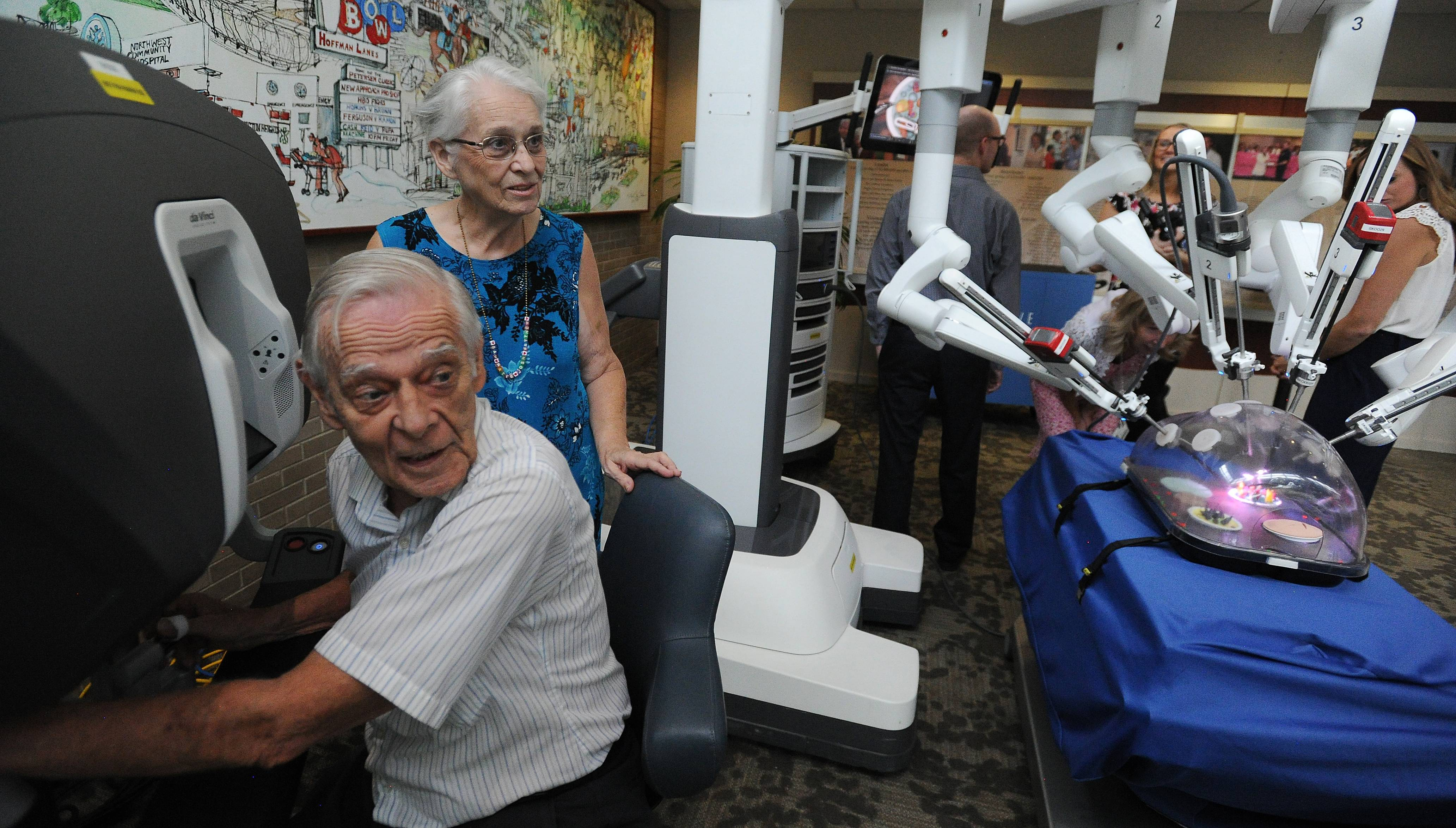 Kent Ulmer tests the da Vinci surgical machine Wednesday at Northwest Community Hospital, where his wife, Martha, became the 5,000th patient to have surgery done with the robot.