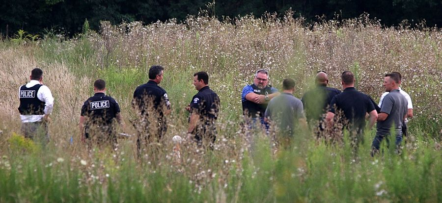 DuPage County and West Chicago authorities remained mum Wednesday about a body found a day earlier wrapped in a smoldering blanket on the 1300 block of Joliet Street.