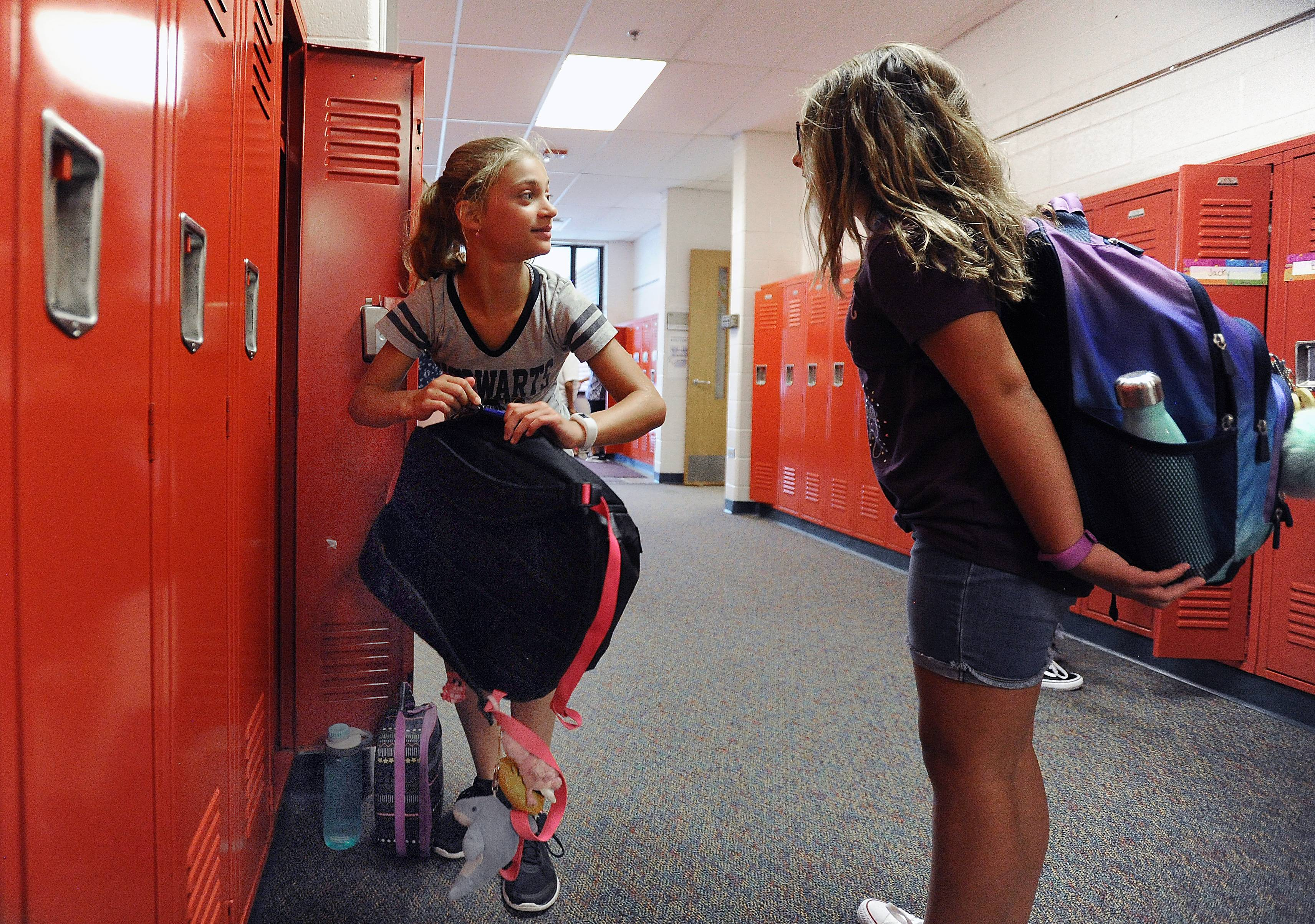 """It's going to be good"" is how Isabel Steinbach, 11, of Palatine described her first day of school at Virginia Lake Elementary School in Palatine as she talks to a fellow 6th grader before heading off to class Wednesday."
