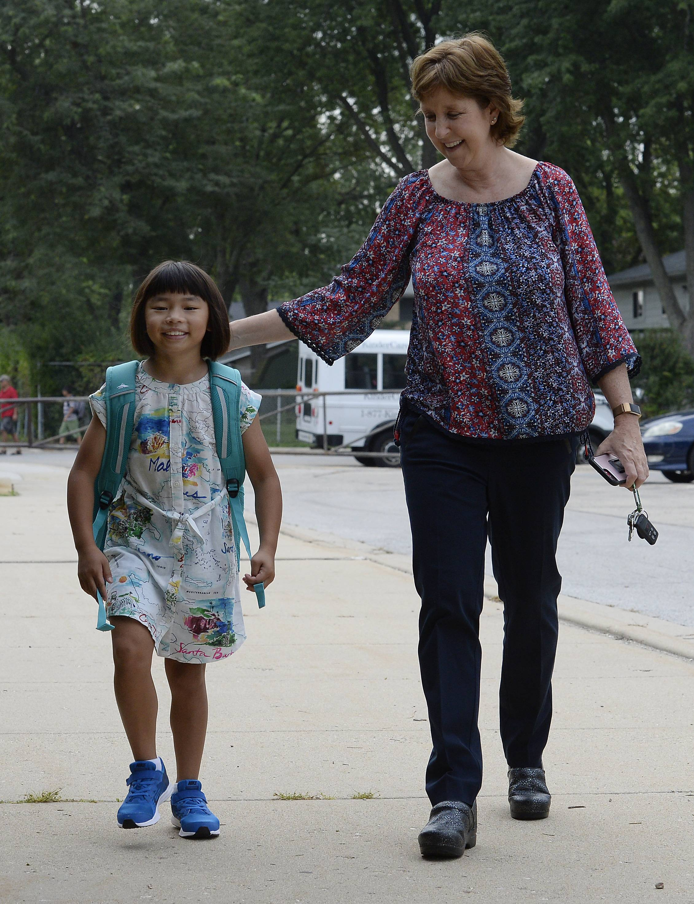 Grace Cimaglio, 8, of Palatine walks with her mom, Kim, as she as Grace heads to her 3rd grade class on her first day of school at Virginia Lake Elementary School in Palatine on Wednesday.